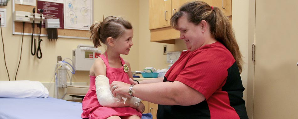 Nurse providing care with young child at Wiarton Hospital